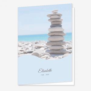 Rouwkaart Gestapelde stenen op het strand